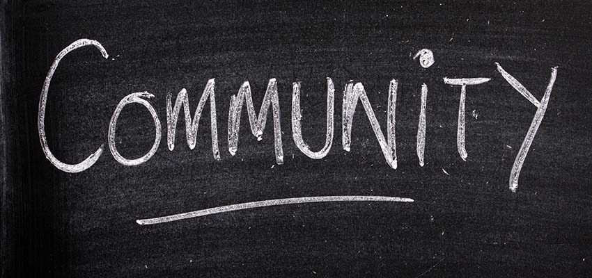 The word Community written on a blackboard